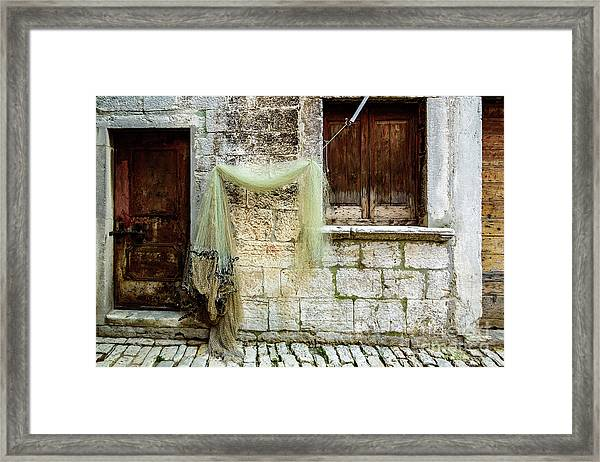 Fishing Net Hanging In The Streets Of Rovinj, Croatia Framed Print