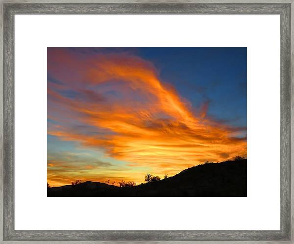 Flaming Hand Sunset Framed Print