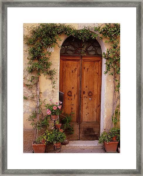 Flowered Tuscan Door Framed Print