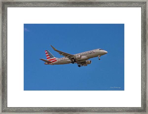 Flying In American Eagle Embraer 175 N426yx Framed Print