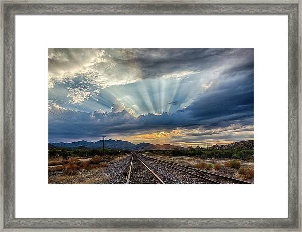 Follow The Rays Framed Print