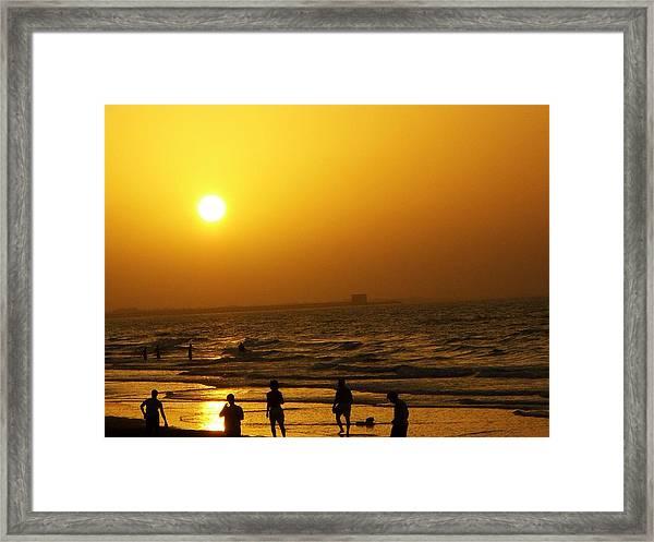 Football And Sunset At The Beach Framed Print by Sunaina Serna Ahluwalia