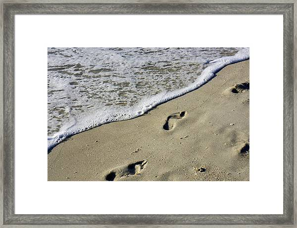 Footprints On The Beach Framed Print