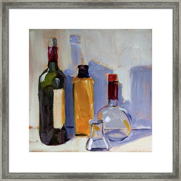 Four Bottles Framed Print