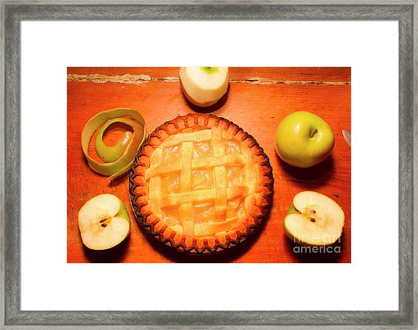 Freshly Baked Pie Surrounded By Apples On Table Framed Print