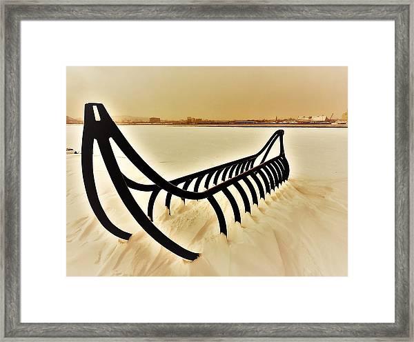 Frozen River And Canoe Framed Print