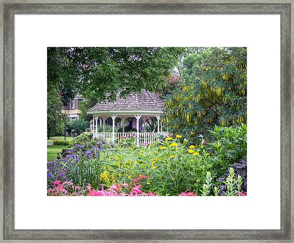 Framed Print featuring the photograph Gazebo With Summer Blooms by Kari Yearous