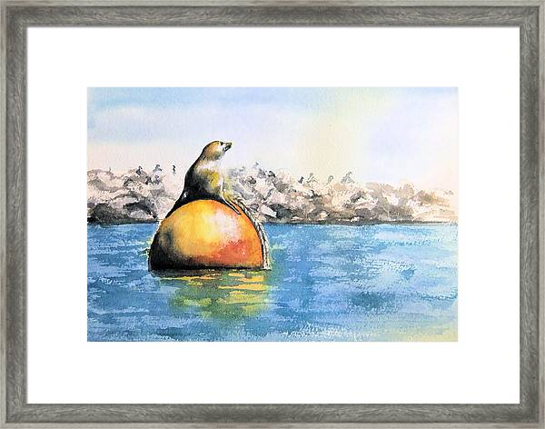 Girl And Buoy Framed Print