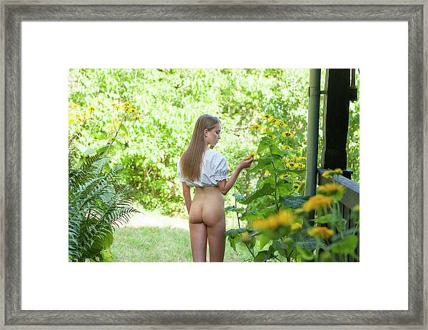 Girl In Swedish Garden Framed Print