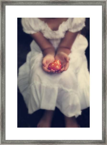 Girl Is Holding A Heart Framed Print