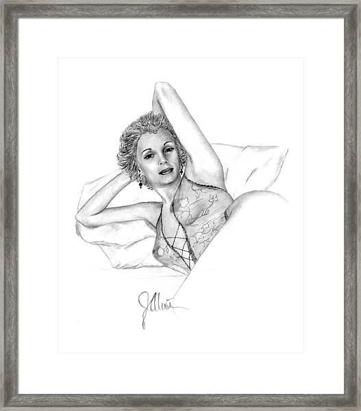 Girl On A Pillow Framed Print