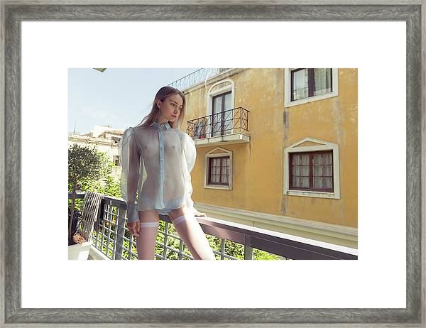 Girl On Balcony Framed Print