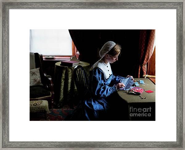 Girl Sewing Framed Print