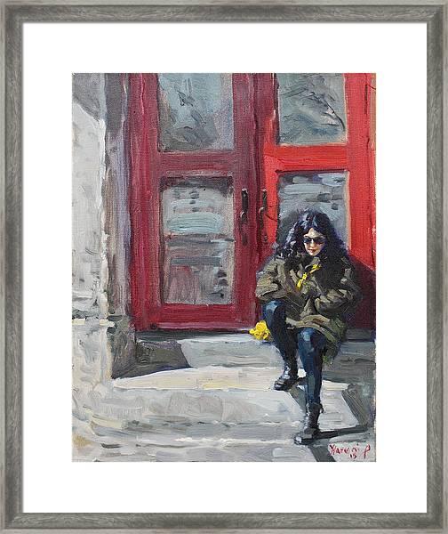 Girl Sitting At Red Doorstep Framed Print