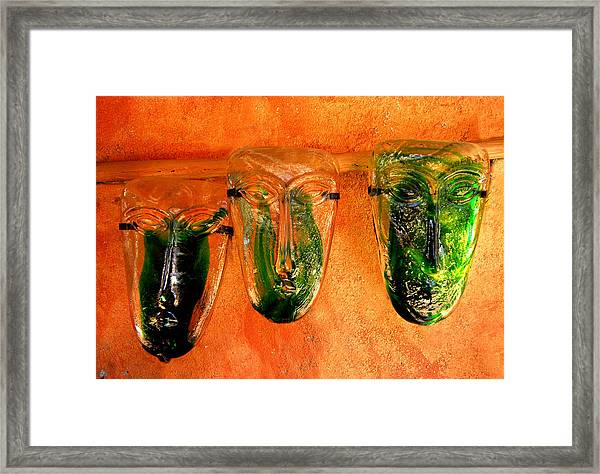 Glass Masks Framed Print