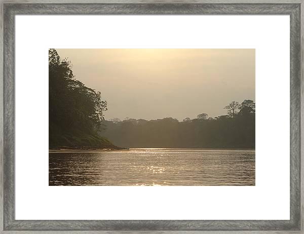 Golden Haze Covering The Amazon River Framed Print