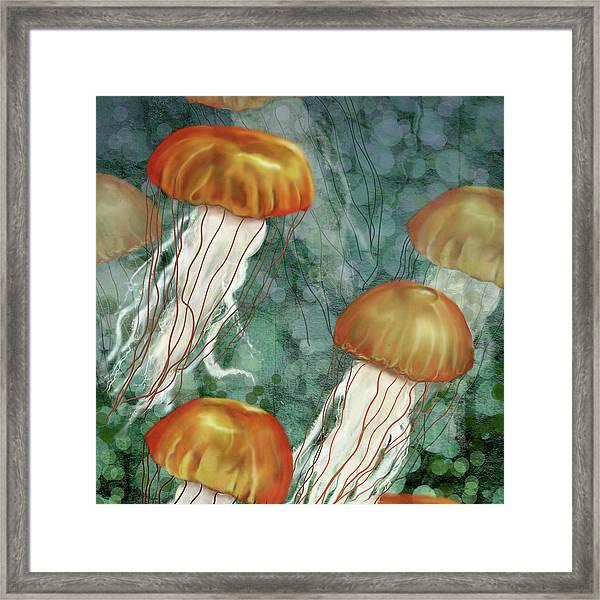 Golden Jellyfish In Green Sea Framed Print