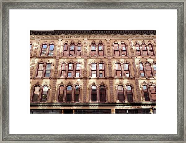 Golden Wall Of Windows And Architecture Light In Grand Rapids Michigan Framed Print