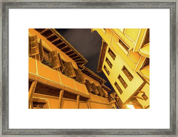 Golden Yellow Night - Chic Zigzags Of Oriel Windows And Serrated Roof Lines Framed Print