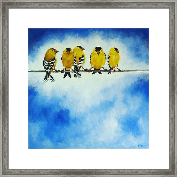 Goldfinch On A Wire Framed Print