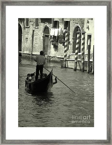 Gondolier In Venice   Framed Print