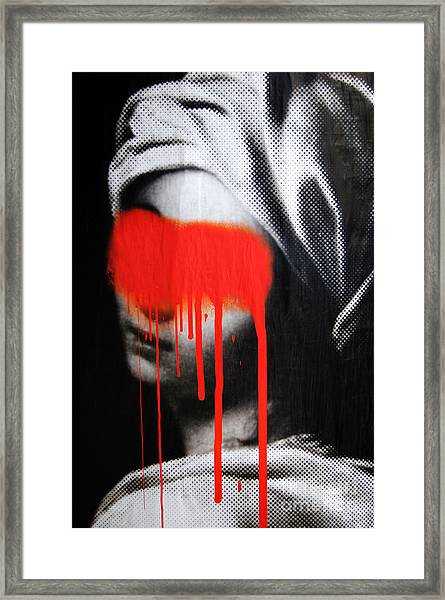 Graffiti On A Poster Krakow Poland Framed Print by Wayne Higgs