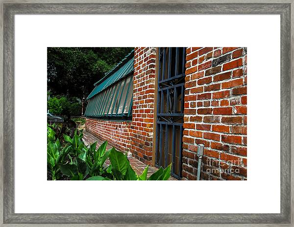 Green House Brick Wall Framed Print