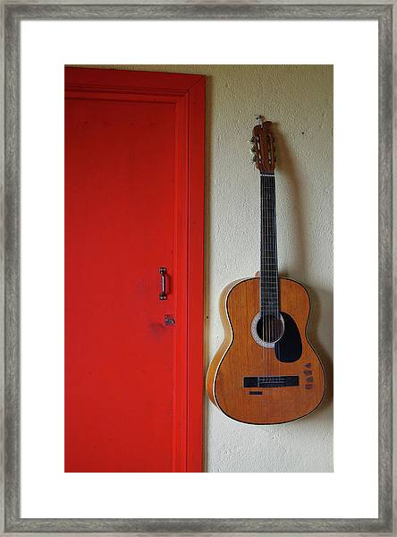 Guitar And Red Door Framed Print