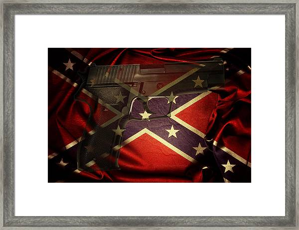 Gun And Confederate Flag Framed Print