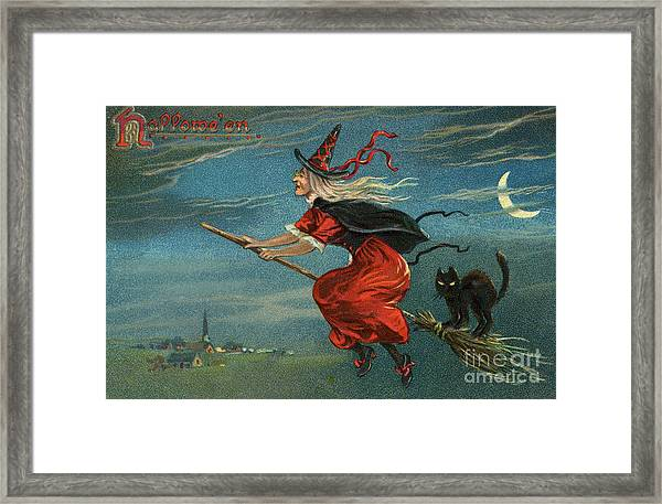 Halloween Witch And Black Cat Riding Broom At Night Framed Print