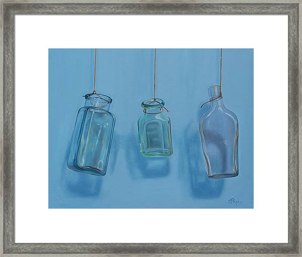 Hanging Bottles Framed Print
