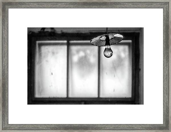 Hanging Light By Window Framed Print