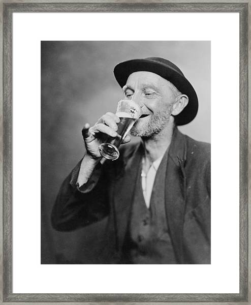 Happy Old Man Drinking Glass Of Beer Framed Print