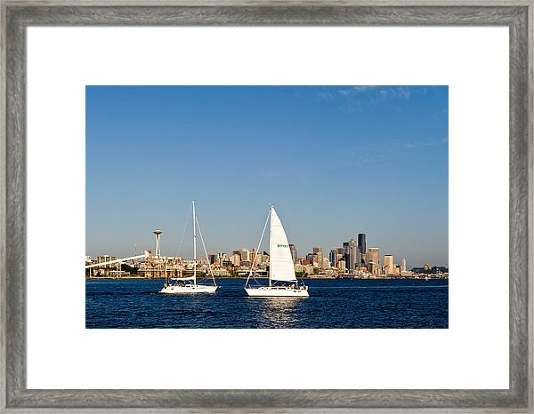 Head To Head In Seattle Framed Print by Tom Dowd