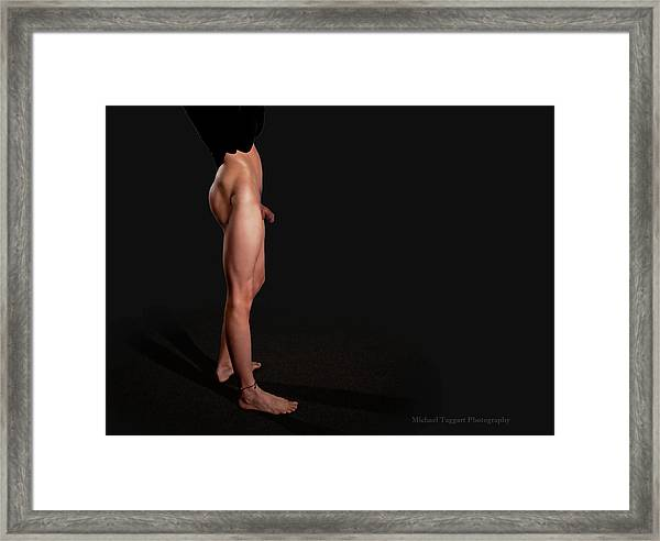 Framed Print featuring the photograph He's Got Legs Part 2 by Michael Taggart