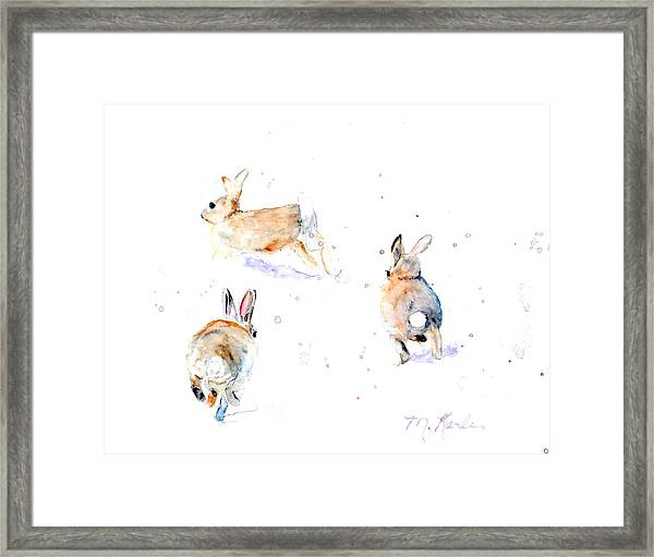 Hightailing Bunnies Framed Print