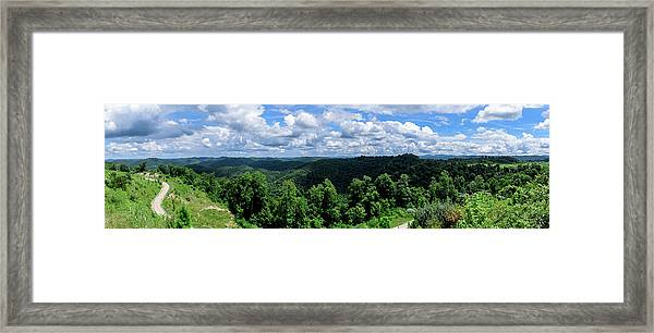 Hills And Clouds Framed Print