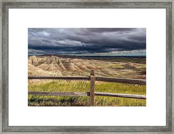 Hills Behind The Fence Framed Print