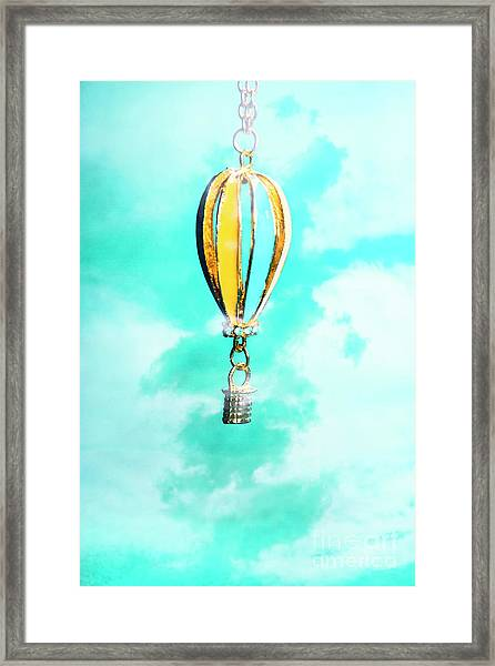 Hot Air Balloon Pendant Over Cloudy Background Framed Print