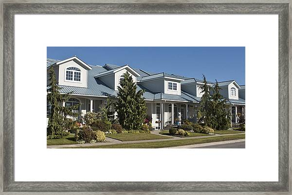 Housing Near Myers Pier Framed Print by Michael Rutland