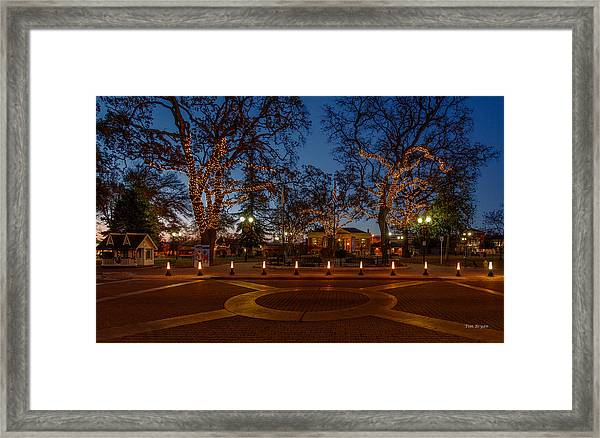 In The Center Of Town At The Crack Of Dawn Framed Print