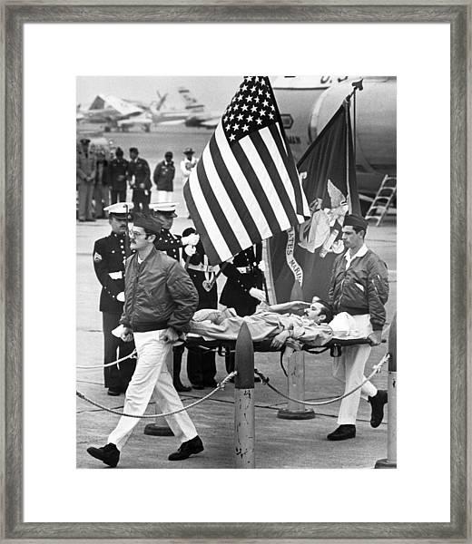 Injured Pow Salutes Flag Framed Print