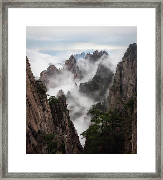Invisible Hands Painting The Mountains. Framed Print