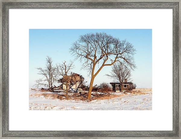 Island In The Snow Framed Print
