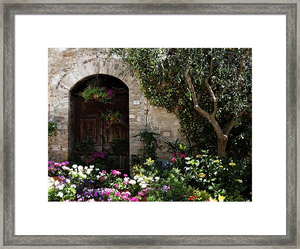 Italian Front Door Adorned With Flowers Framed Print