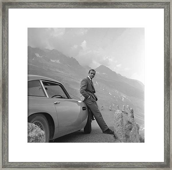 James Bond And His Aston Martin Framed Print