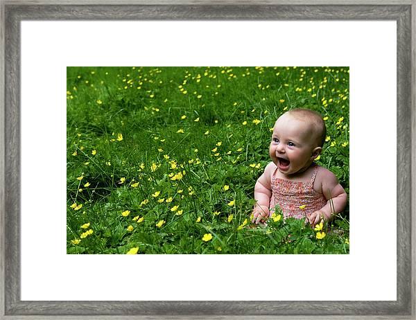 Framed Print featuring the photograph Joyful Baby In Flowers by Lorraine Devon Wilke