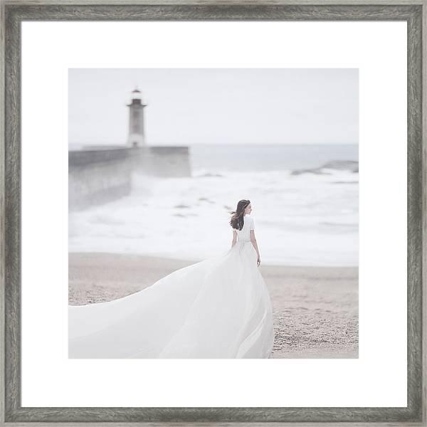 Katya And The Lighthouse Framed Print