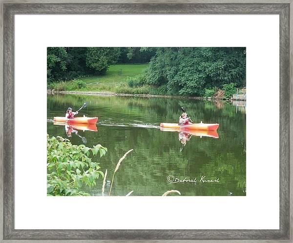 Kayaks On The River Framed Print