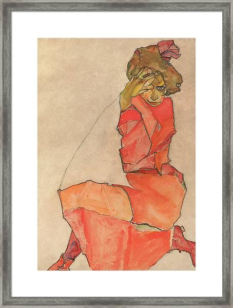 Kneeling Female In Orange-red Dress Framed Print